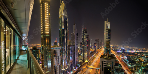 Foto op Canvas Stad gebouw Dubai skyline during night with amazing city center lights and Sheikh Zayed road traffic,United Arab Emirates.