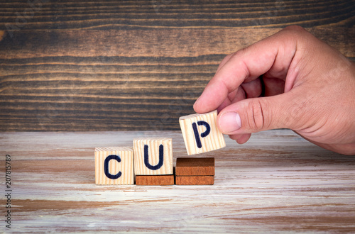 Fototapety, obrazy: cup. Sports competitions, success at work or achievements in training. Wooden letters on the office desk, informative and communication background