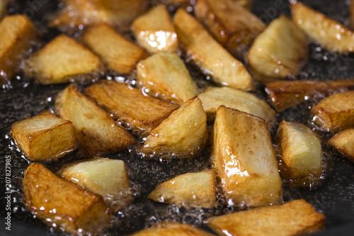 Fotografie, Obraz  Frying Fresh Raw chopped Potatoes In Pan With Hot sunflower Oil