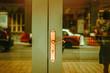 Green double doors with golden handle. Modern classic exterior design. Vintage tone filter effect