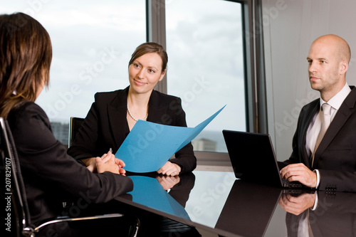Job interview with two persons from a human resources team and a candidate Canvas Print