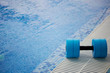Leinwanddruck Bild - The kettlebell for water aerobics lies on the edge of the pool. Near the water. Exercise, swimming and a healthy lifestyle