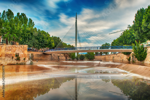 View of a suspension bridge over the safe river in Murcia