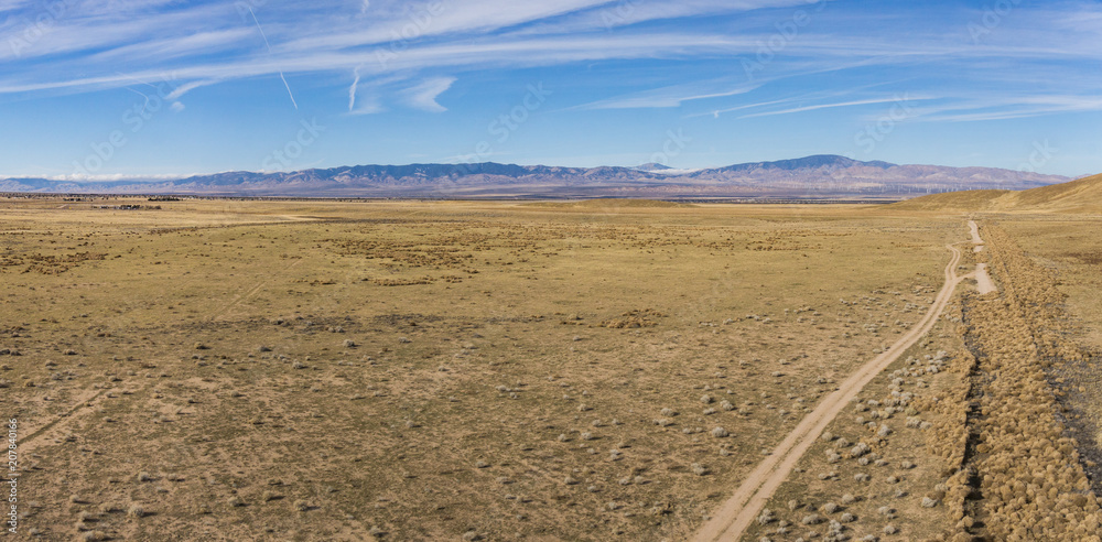 Panorama of dry desert plain during the California drought in central plain.
