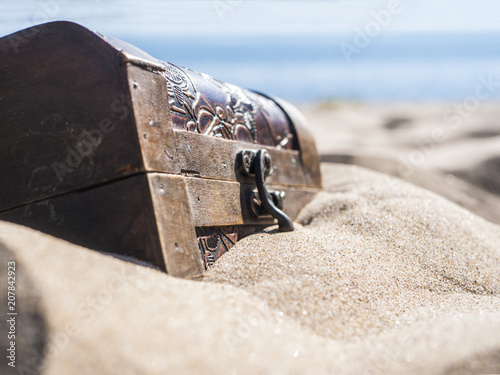 Fotografie, Obraz close up locked chest in the sand on the beach