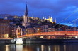 Panoramic view of Saint Georges church and footbridge across Saone river, Old town with Fourviere cathedral during evening blue hour in Lyon, France