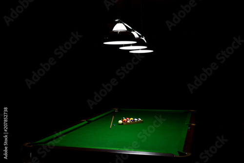 Canvas Game of billiards on a table with green cloth