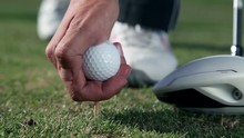 Close Up Shot Of A Golfers Walk Towards A Point Where He Sticks A White Golf