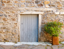 Door And Flower Pot On A Greek Island