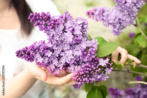 Foto op Canvas Lilac Young woman with blossoming lilac outdoors on spring day