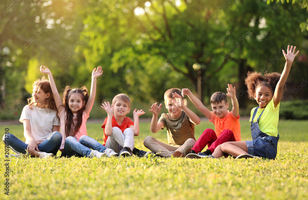 Fototapety, obrazy: Cute little children sitting on grass outdoors on sunny day
