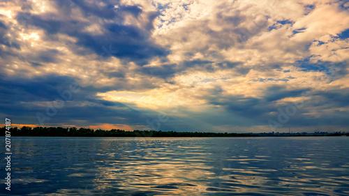 Printed kitchen splashbacks Fishing Sunset before a thunderstorm on the river