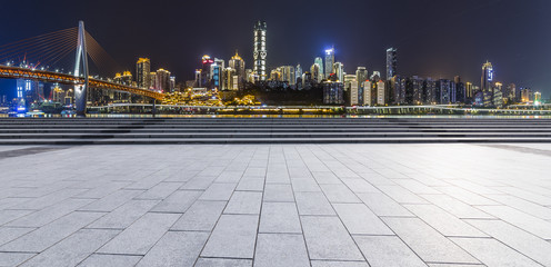 Panoramic skyline and buildings with empty road,chongqing city at night