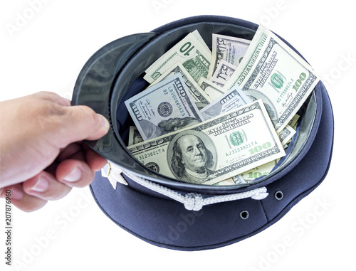 Fotomural A policeman's hand holds a cap with money- symbolic image of a bribe or corruption
