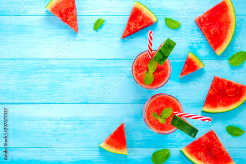 Watermelon juice smoothies in the glasses on light blue wood background