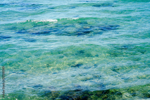 Poster Waterlelies Clear water background, blue natural texture. Sea wave close up, low angle view.