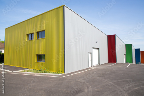 Staande foto Industrial geb. gray facade made of aluminum panels with doors and windows on industrial building