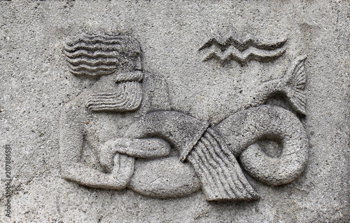 Zodiac - Aquarius or Water-bearer, a stone relief Wallpaper Mural