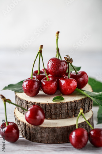 Fresh cherry with water drops on rustic wooden background. Fresh cherries background. Healthy food concept