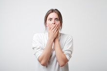 Concept Of Censorship. Closeup Concerned Scared Shocked Caucasian Woman In White T-shirt Covering Her Mouth