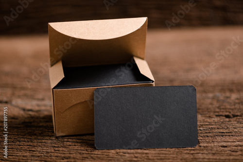 Fényképezés  black blank business name card for mock up on wood background