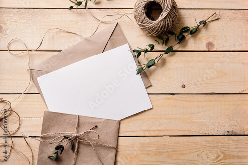 Fototapeta Top view of envelope and blank greeting card  obraz