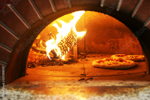 Wall Murals Pizzeria Neapolitan pizza in a wood stove