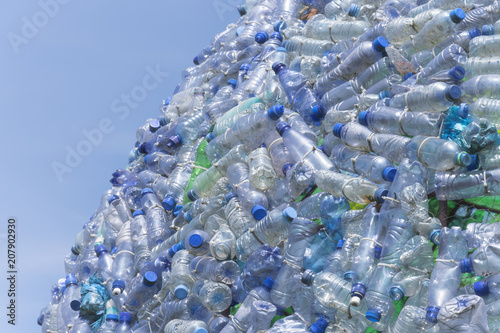 Fotografie, Obraz  A lot of plastic waste bottles with a beautiful blue sky in the background