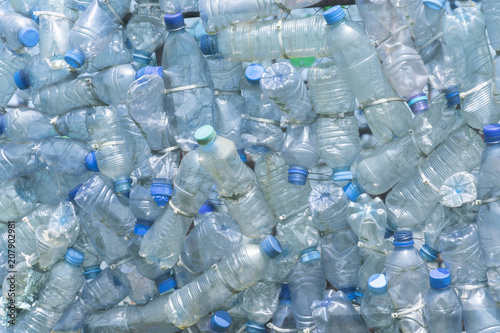 Obraz na plátně  Transparent blank plastic bottles with blue lids