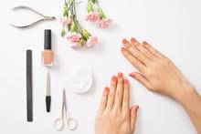 Female Hands Applying Purple N...