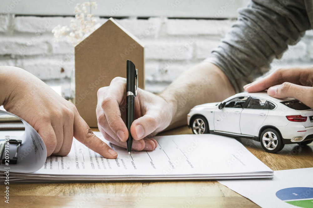 Fototapety, obrazy: Auto insurance policy signature.  Home owners insurance paperwork.