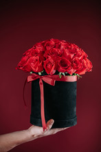 Sexy Man Holding Box Of Red Roses In His Hands For Beloved Woman As A Gift. Romantic Date.