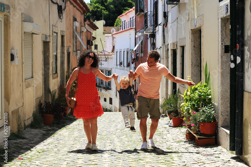 Obraz Lisbon Portugal, a young family walks through the old town - fototapety do salonu