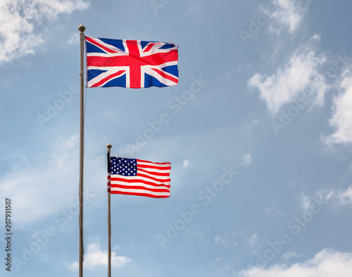 British and American flags flying on a sunny day Wallpaper Mural