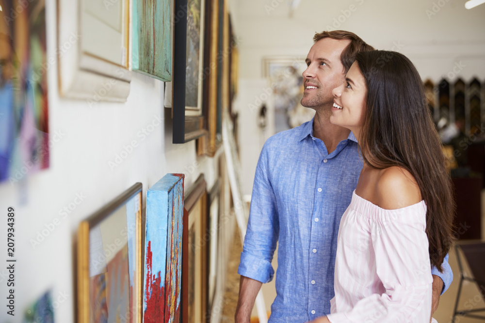 Fototapety, obrazy: Couple Looking At Paintings In Art Gallery Together