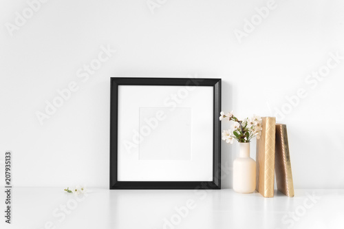 Valokuva  Frame mock up with spring cherry bouquet and gold notebooks