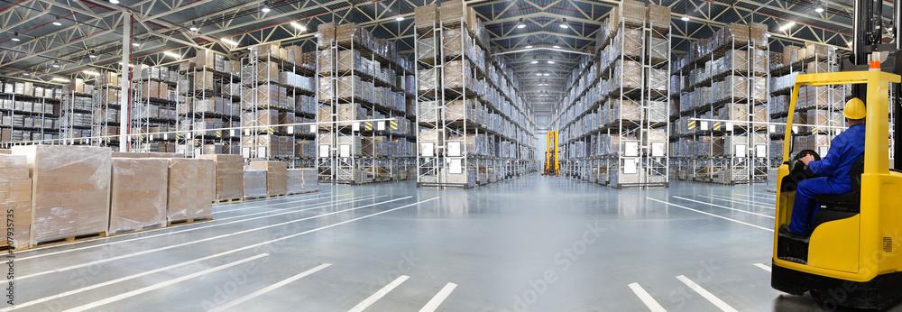 Fototapeta Huge distribution warehouse with high shelves