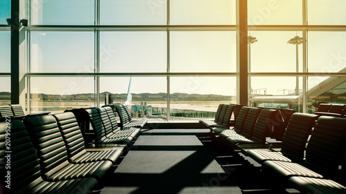 Foto op Aluminium Luchthaven Passenger seat in Departure lounge for see Airplane at Airport terminal, Travel concept with copy space. Silhouette background