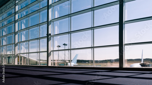 Poster de jardin Aeroport Walkway and glass curtain wall with Airplane background at Airport terminal, Travel concept with copy space. Silhouette background
