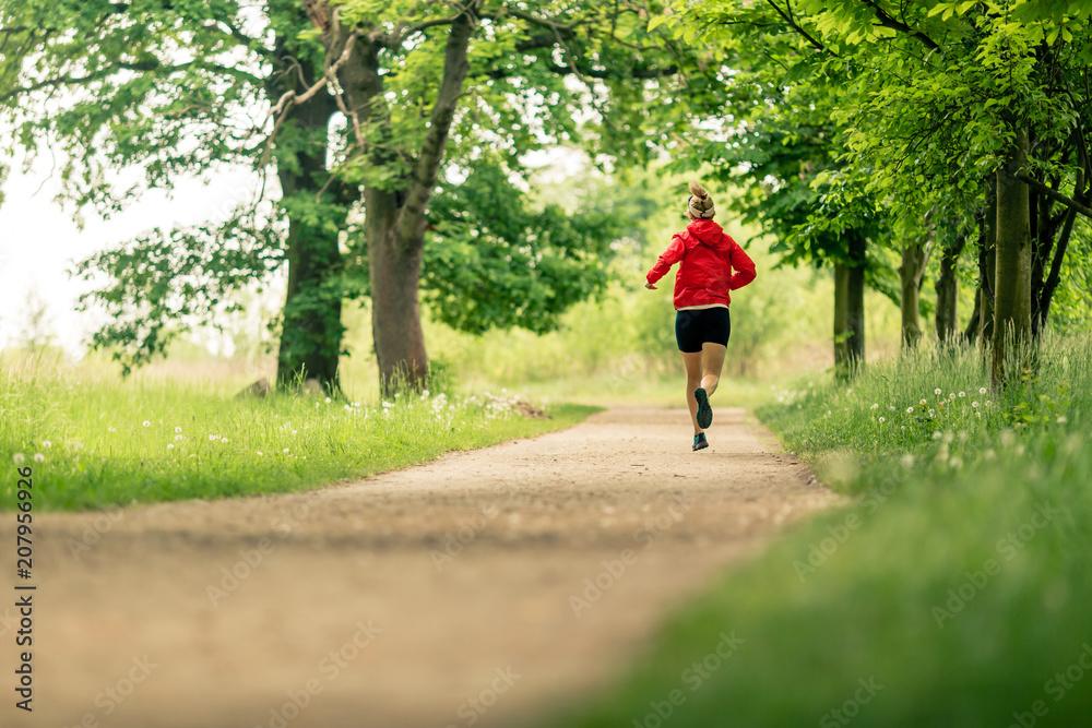 Fototapeta Running woman, enjoying summer day in park