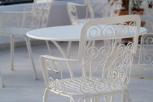 Openwork White . Metal Chair In The Cafe