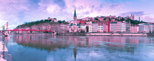 Panoramic view of Saint Georges church and footbridge across Saone river, Old town with Fourviere cathedral at gorgeous sunset in Lyon, France