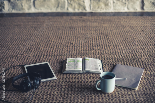 Photo of open Bible, coffee, notepad and tablet on a rug Wallpaper Mural
