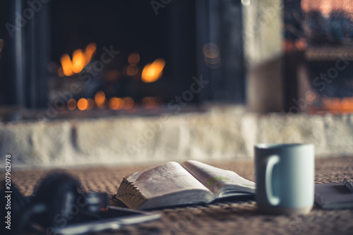 Vászonkép Shallow depth of field photo of open Bible, coffee, notepad and tablet in front