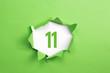 Leinwanddruck Bild - gruene Nummer 11 auf gruenem Papier