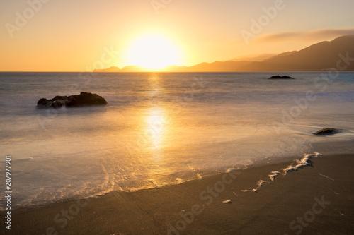 Foto op Aluminium Strand Tramonto Oceano