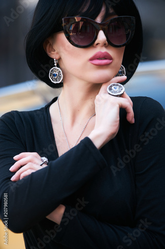 Young woman with dark hair in black bodysuit and sunglasses posing near  supercar. Portrait of a Beautiful brunette woman with yellow sport car - Buy  this ... 8a7efde55