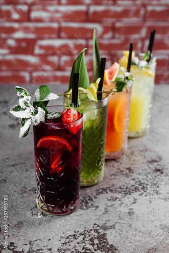 Obraz na plátne Four fruit cocktails on table.