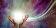 Leinwandbild Motiv Stunning Healing Energy phenomenon  - female hands reaching up into a ball of white  energy with a laser trail and pink green ethereal energy field  background