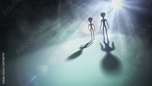 Tableau sur Toile Silhouettes of aliens and bright light in background